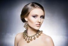 Portrait of beautiful girl in shiny jewels Stock Photo
