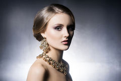 Portrait of beautiful girl in shiny jewels Royalty Free Stock Photography