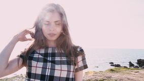 Portrait of a beautiful girl on the shore of the beach. 1 stock video