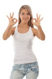 Portrait of beautiful girl showing OK sign. And smiling, over white background Royalty Free Stock Photos