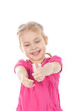 Portrait of a beautiful girl showing thumbs up Stock Photo