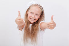 Portrait of a beautiful girl showing thumbs up on Stock Photos