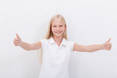Portrait of a beautiful girl showing thumbs up on Royalty Free Stock Images