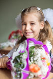 Portrait of beautiful girl sitting at a desk. With a bouquet of flowers royalty free stock photo