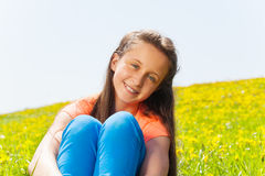 Portrait of beautiful girl sitting in the park Royalty Free Stock Photos