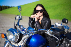 Portrait of beautiful girl sitting on retro motorcycle Stock Photography