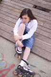 Portrait of beautiful girl with skates Royalty Free Stock Image