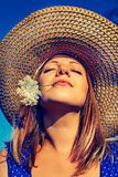 Portrait of a beautiful girl in the sky. Beautiful girl in  hat  on background blue sky Royalty Free Stock Images