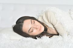 Beautiful  girl sleeping. Portrait of a beautiful girl sleeping in bed Royalty Free Stock Photography