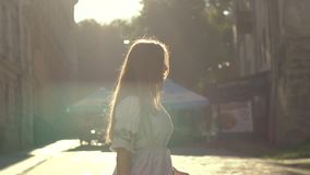 Portrait Of Beautiful Girl Slow motion. Day shot of a beautiful girl walking behind the sunlight stock video