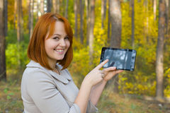Portrait of beautiful girl with the smartphone Royalty Free Stock Image