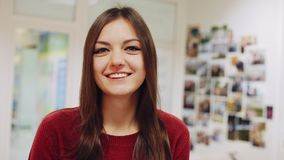 Portrait of beautiful girl smiles for camera and gives thumbs up stock footage