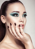 Portrait of Beautiful girl with smokey eyes make up Stock Photography