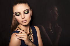 Portrait of beautiful girl with smokey eyes makeup and bijou Stock Photos