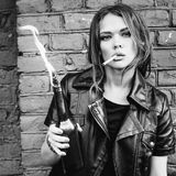 Portrait of beautiful girl smoking with Molotov cocktail Royalty Free Stock Photos