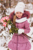 Portrait of a beautiful girl snow winter day with a bouquet of roses Royalty Free Stock Photo