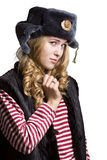 Portrait of a beautiful girl in a soldier's cap Royalty Free Stock Images
