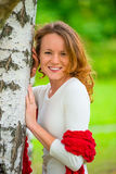 Portrait of a beautiful girl in spring park. Near birch Royalty Free Stock Photos