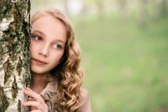 Portrait of beautiful girl standing close to tree Stock Image