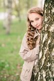 Portrait of beautiful girl standing close to tree Stock Photography
