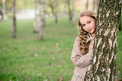 Portrait of beautiful girl standing close to tree Stock Photos