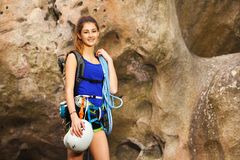 Girl standing with rock climbing equipment Stock Image
