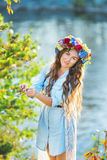 Portrait of a beautiful girl standing on a lake background. In sunny day Stock Photo