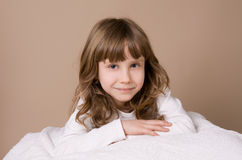 Portrait of beautiful girl on studio. Beige background Royalty Free Stock Photos