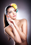 Portrait of beautiful girl in studio with flowers in her hair Royalty Free Stock Images