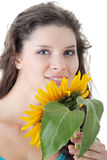 Portrait of a Beautiful girl with sunflower Stock Images