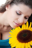 Portrait of a Beautiful girl with sunflower Stock Photos