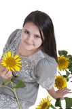 Portrait of a beautiful girl with sunflowers Stock Photo