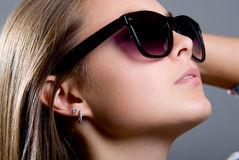 Portrait of a beautiful girl in sunglasses Stock Photos
