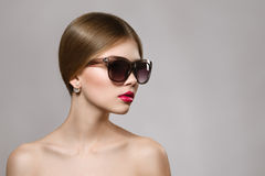 Portrait of beautiful girl in sunglasses with red lips. Concept of beauty Stock Photos