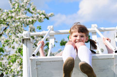 Portrait of beautiful girl on a swing Royalty Free Stock Images
