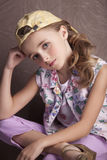 Portrait of beautiful girl in  t-shirt and trousers in the inverted cap room beforehand Royalty Free Stock Images