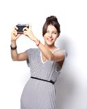Portrait of beautiful  girl taking selfie Royalty Free Stock Photography