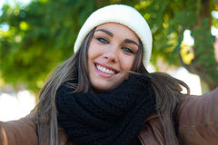 Portrait of beautiful girl taking a selfie with mobile phone. stock image