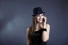 Portrait of beautiful girl talking on phone. Portrait of young girl with hat talking on the phone stock photos