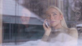 Portrait of a beautiful girl talking on the phone. stock video