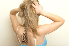 Portrait of a beautiful girl with tattoo. Beautiful girl with tattoo on shoulders royalty free stock image