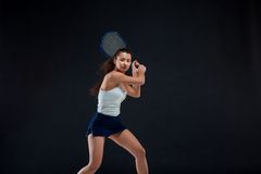 Portrait of beautiful girl tennis player with a racket on dark background Royalty Free Stock Photo