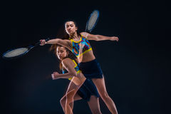 Portrait of beautiful girl tennis player with a racket on dark background Stock Photos
