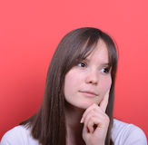 Portrait of beautiful girl thinking against red background Stock Image