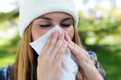 Portrait of beautiful girl with tissue having flu or allergy. Royalty Free Stock Image