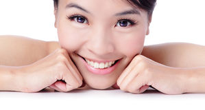 Portrait of beautiful girl touching her pretty fac. E with healthy skin - white background, model is a asian beauty royalty free stock photos