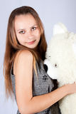 Portrait of the beautiful girl and toy Teddy. Royalty Free Stock Image