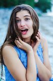 Beautiful young woman in a blue dress. royalty free stock photography