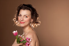 Portrait of a beautiful girl with tulips Royalty Free Stock Images