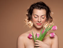 Portrait of a beautiful girl with a tulips Stock Photos